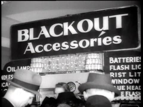 cu people buying blackout accessories / new york city new york united states - 1942年点の映像素材/bロール