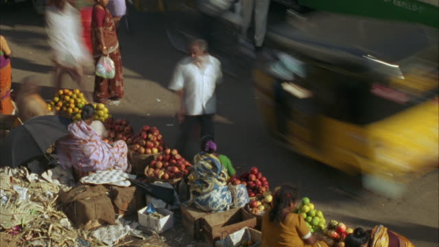 t/l, ms, ha, people buying fruits on street market, madras, india - south asia stock videos & royalty-free footage