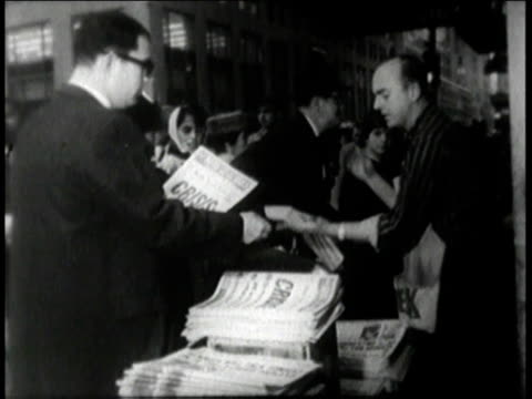 people buying newspapers / newspaper with headline reading highest national urgency jfk talks to nation tonight - cuban missile crisis stock videos & royalty-free footage