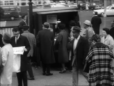 b/w 1963 people buying reading newspapers at newsstand on sidewalk after jfk's assassination - attentat auf john f. kennedy stock-videos und b-roll-filmmaterial