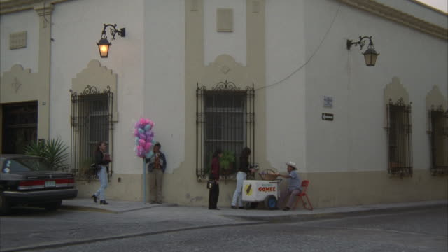 ms, people buying sweets on street corner, monterrey, mexico - 20 29 years stock videos & royalty-free footage