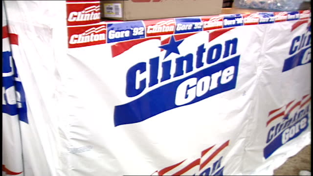 vídeos de stock e filmes b-roll de people buying various clinton / gore items like buttons and t-shirts - 1992