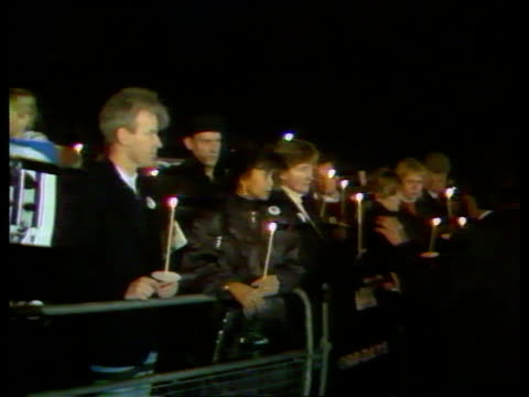 people by barriers holding candles london at vigil int st brides ms jill morrell lights candle tx church - jill morrell stock videos & royalty-free footage
