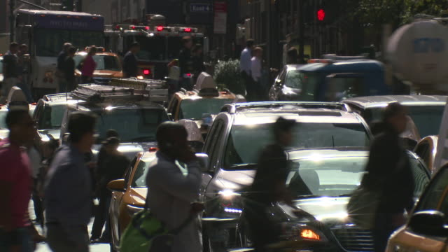 people, cabs, and cars are traveling the streets of manhattan in this busy street scene. - cement mixer stock videos and b-roll footage