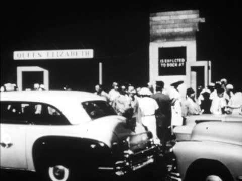 people cabs at port dock w/ queen elizabeth sign tu ws people standing along railing on passenger ship ms cabs at dock tu ws bow of rms queen... - ocean liner stock videos and b-roll footage