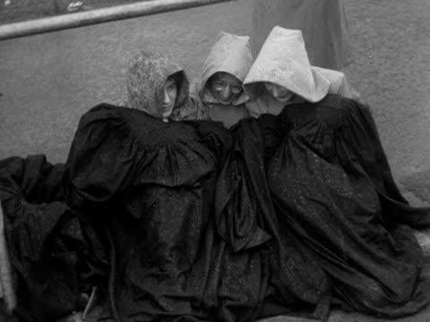 people camped out on the streets of central london for the coronation, huddle under blankets. 1953. - number of people stock videos & royalty-free footage