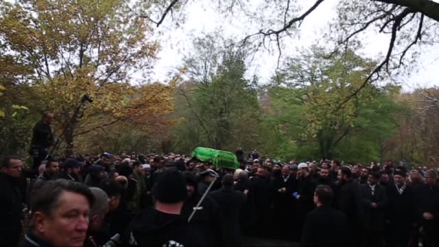 people carry bosnian refugee mohamed januzi's body, four-year-old boy snatched from overcrowded german refugee registration centre and found dead... - 2015 stock-videos und b-roll-filmmaterial