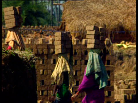 people carry stacks of bricks on their heads - brick stock videos & royalty-free footage