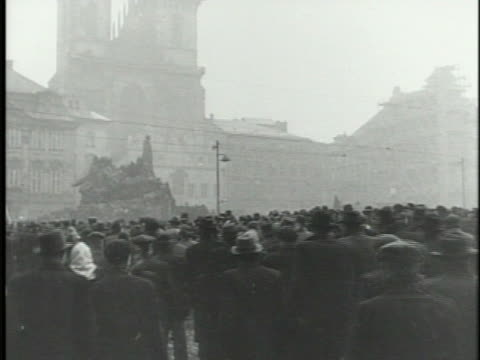 people carrying banners, large crowd moving into old town square, prague, xws packed square w/ communist party leader klement gottwald w/ others on... - prague old town square stock videos & royalty-free footage