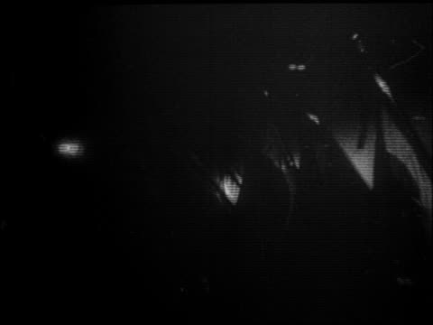 stockvideo's en b-roll-footage met people carrying nazi flags in parade at night / hitler just appointed chancellor - 1933
