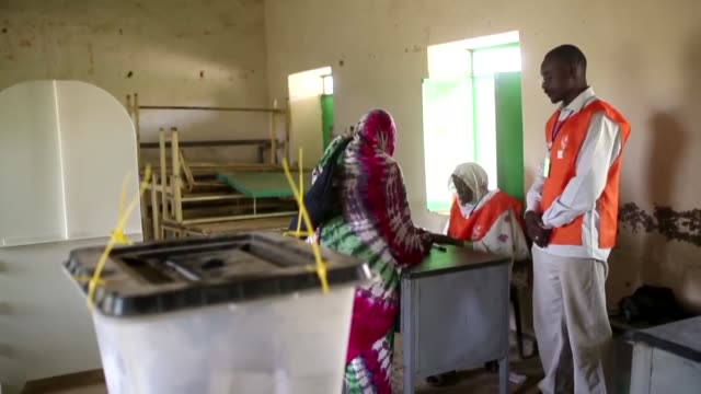 people cast their ballots at al mustakbel polling station during last day of referendum in the al fasher town in darfur sudan on april 13 2016 - last day stock videos and b-roll footage
