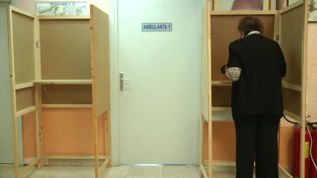 people cast their ballots for parliamentary election at a polling station in podgorica, montenegro on august 30, 2020. over half a million voters are... - last stock videos & royalty-free footage