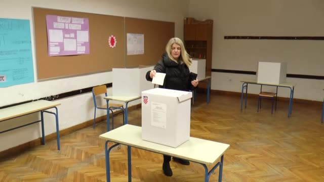 people cast their ballots for the presidential election runoff at a polling station in zagreb croatia on january 05 2020 - zagreb stock videos & royalty-free footage