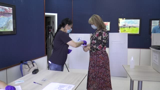 people cast their ballots in the early general elections at a polling station on july 15, 2020 in skopje, north macedonia. more than 1.8 million... - 14 15 years stock videos & royalty-free footage