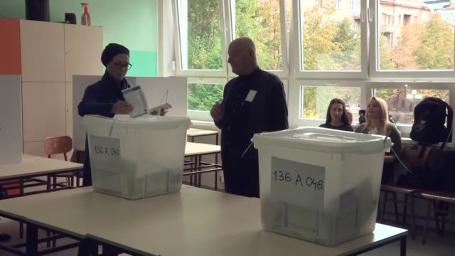 people cast their ballots in the presidential and parliamentary elections at a polling station in sarajevo bosnia and herzegovina on october 07 2018... - ballot slip stock videos & royalty-free footage