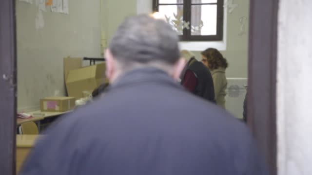 people cast their votes at polling station for a referendum on constitutional reforms in florence italy on december 4 2016 former italian prime... - 2016 stock-videos und b-roll-filmmaterial