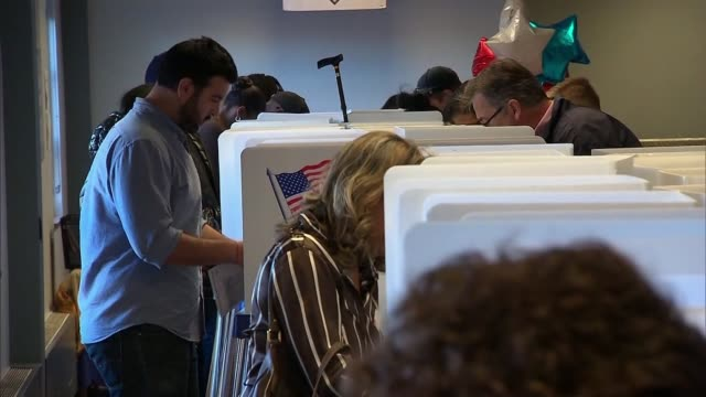 stockvideo's en b-roll-footage met kswb people casting their ballots at voting booths - stembus