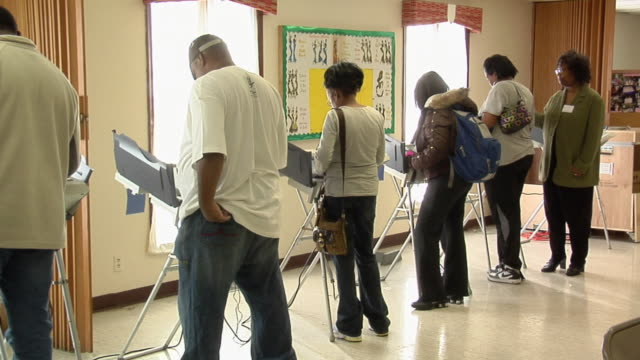 MS, ZO, People casting their votes at electronic voting machines, Toledo, Ohio, USA
