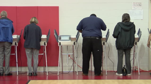 ms, pan, people casting their votes at electronic voting machines, toledo, ohio, usa - voting booth stock videos and b-roll footage
