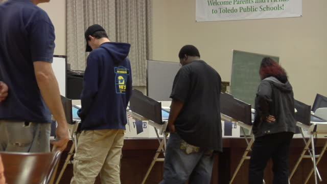 ms, pan, people casting their votes at electronic voting machines, toledo, ohio, usa - voting stock videos & royalty-free footage