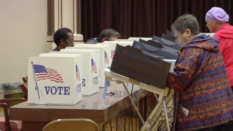ms, zo, people casting their votes at polling place, toledo, ohio, usa - röst bildbanksvideor och videomaterial från bakom kulisserna