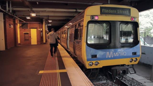 MS T/L people catching train / Melbourne, Victoria, Australia