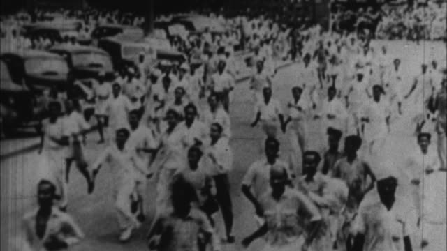 people celebrate india's independce from britain / india - anno 1947 video stock e b–roll