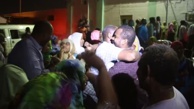 people celebrate outside the kobar prison during the release of political detainees from the prison on february 18 2018 in khartoum sudan sudan's... - prison release stock videos & royalty-free footage