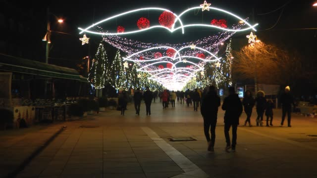 People celebrate the arrival of the New Year at Zahir Pajaziti square in Pristina Kosovo on January 01 2017