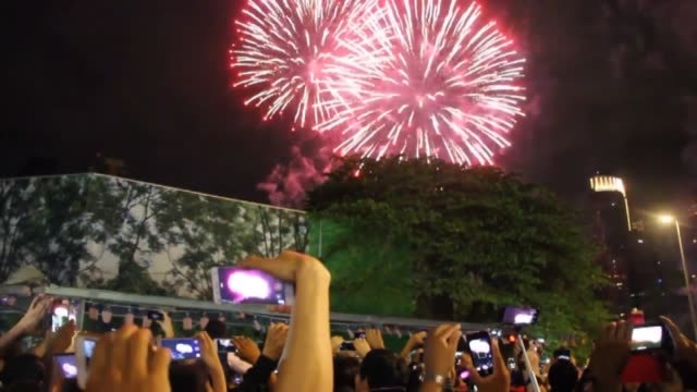 people celebrate the arrival of the new year near malaysia's petronas towers in kuala lumpur on january 01 2018 - petronas twin towers stock videos & royalty-free footage