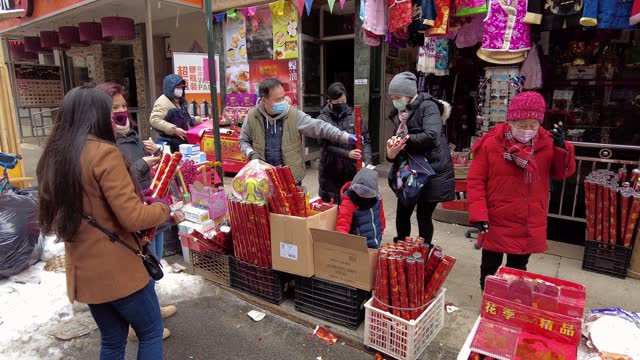 people celebrate the beginning of the lunar new year on mott street in manhattan's chinatown on february 12, 2021 in new york city. lunar new year,... - chinatown stock videos & royalty-free footage