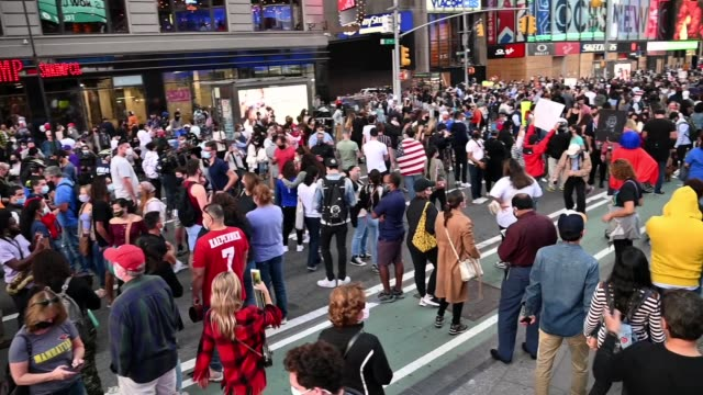 people celebrate the election of joe biden as the 46th president of the united states in times square on november 07, 2020 in new york city. - times square manhattan stock videos & royalty-free footage