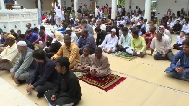 people celebrate the muslim festival of eid al-adha at the diyanet center of america in lanham, maryland, usa on august 21, 2018. maryland secretary... - maryland us state stock videos & royalty-free footage