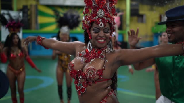 people celebrating and dancing brazilian carnival at school carnival - parade stock videos & royalty-free footage
