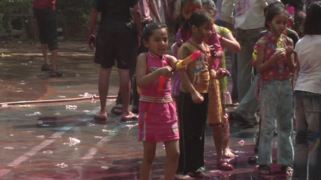 cu people celebrating holi / mumbai, maharashtra, india - squirting woman stock videos and b-roll footage
