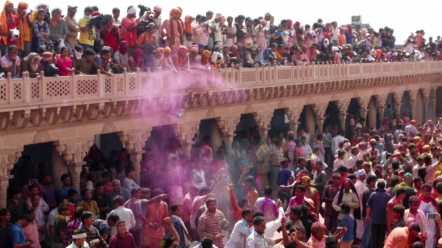 People celebrating Holi, the Hindu festival of colour, at a temple complex in India