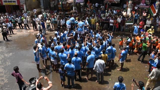 people celebrating janmashtami , dahi handi, mumbai, india. - human pyramid stock videos and b-roll footage