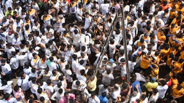 People celebrating Janmashtami , Dahi Handi.