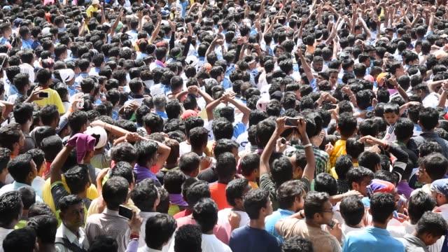 People celebrating Janmashtami , Dahi Handi,