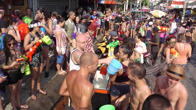 people celebrating thai new year or songkran around the moat and city walls of chiang mai thailand new year is traditionally celebrated by splashing... - chiang mai province stock videos & royalty-free footage