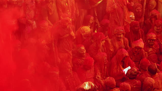 People chanting prayers in a temple during Holi, festival of colors
