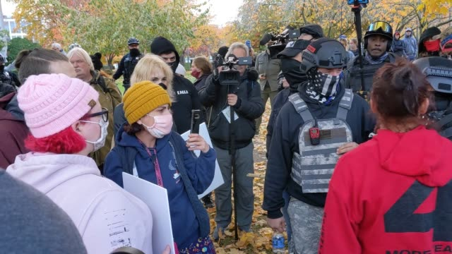 """people chat in a group as trump supporters clash with the opposing side during """"stop the steal""""protests on november 7, 2020 in salem, oregon. angry... - salem oregon stock videos & royalty-free footage"""