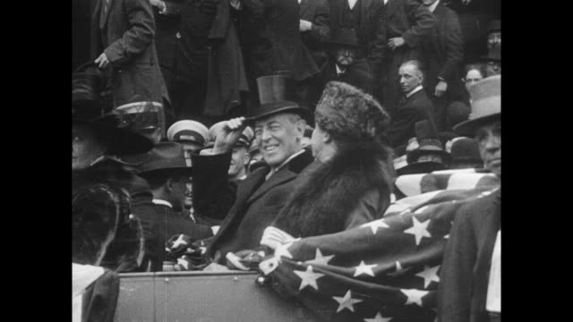 stockvideo's en b-roll-footage met people cheer president wilson at campaign rally / president with 2nd wife edith wilson in car as president waves his hat to crowds - woodrow wilson