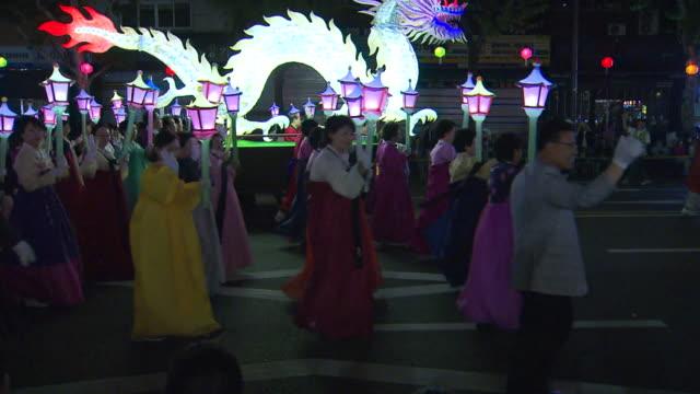 ms people chinese zodiacl lanterns parade on buddha's birthday event on jongro street / seoul, south korea - buddha's birthday stock videos and b-roll footage
