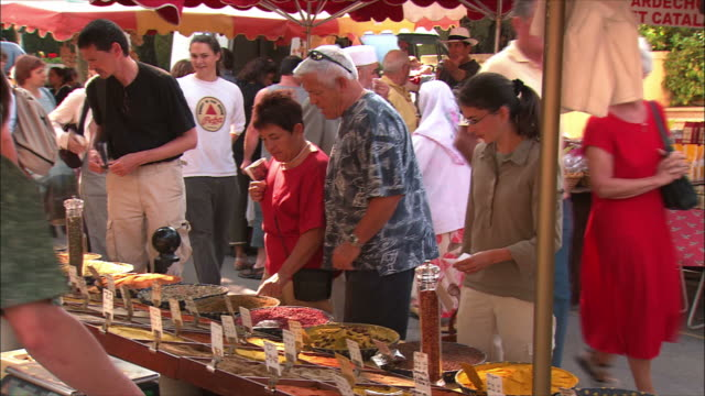 ms zo people choosing spices and herbs at market stall / arles, provence, france - spice stock videos and b-roll footage