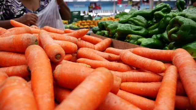 people choosing vegetables at the supermarket - carrot stock videos & royalty-free footage