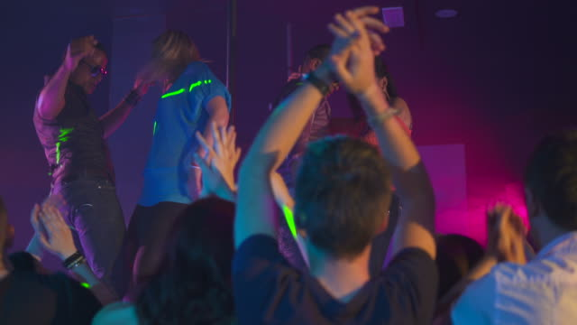 hd dolly: people clapping to the rhythm at night club - showgirl stock videos and b-roll footage