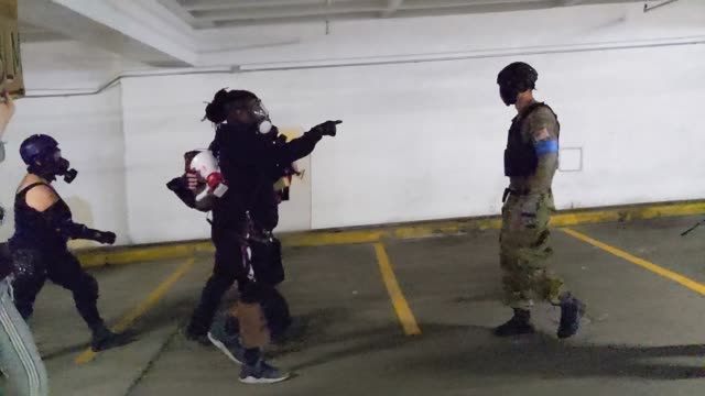 people clash in a parking garage, one with a captain america shield, as right wing groups and portland anti-police protesters face off in front of... - confrontation stock videos & royalty-free footage
