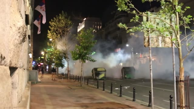 people clash with police in front of the serbian parliament during an anti-government protest on july 10, 2020 in belgrade, serbia. following recent... - serbia stock videos & royalty-free footage