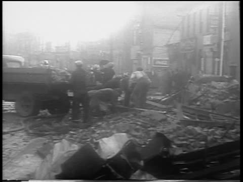 B/W 1938 people cleaning debris from street after hurricane / Northeast US / newsreel